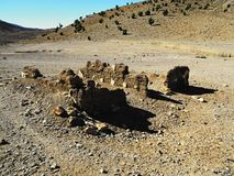 Debris of Moroccan dwelling in desert. The debris of Moroccan dwelling in desert royalty free stock images