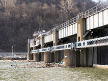 Debris and trash collected at lock sluice gates royalty free stock image