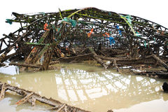 Debris in water. A view of a large pile of twisted metal and other pieces of debris collected in water Stock Photography