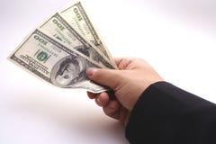 Debt. Man giving 300 hundred dollars Royalty Free Stock Photo