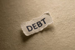 Debt. Picture of a word debt Stock Photography