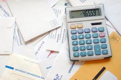 Debt... Bills and invoices with a calculator Royalty Free Stock Image