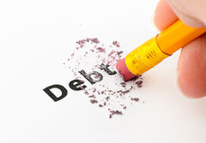 Debt. Being erased by the end of a pencil, word implies Stock Photos
