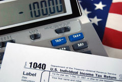 income tax form with calculator Stock Photos