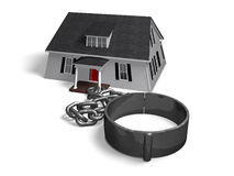 Debt. House attached to a chain and shackle Royalty Free Stock Photo