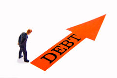 Debt. Miniature with red arrow and text that reads Debt Royalty Free Stock Photography