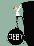 Debt bring down. Business man try hard to climb up the cliff but debt burden bring him down. Business concept on debt Stock Photos
