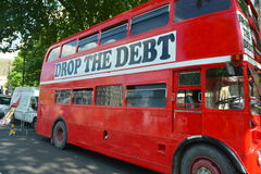 The Debt bus. Drop the debt red London bus parked outside the Houses of Parliament during an austerity protest Stock Images