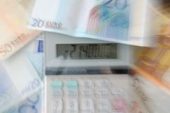 Debt (causing dizziness). An image of a calculator showing debt with Euro as backdrop Stock Photos