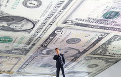 Debt Ceiling. Political figure standing under a ceiling made of US money Stock Image