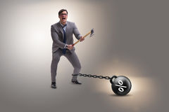 The debt concept with businessman escaping loan burden with axe Stock Image