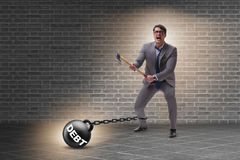 The debt concept with businessman escaping loan burden with axe Royalty Free Stock Images