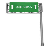 Debt crisis. Highway signboard pointing forward displaying DEBT CRISIS Stock Image