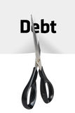 Debt Cutting. Scissors cutting the paper with word Debt in half isolated with clipping path (at ALL sizes royalty free stock image