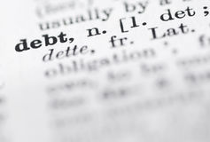 Debt Definition in English Dictionary. Shallow DOF, focus on debt in English dictionary Royalty Free Stock Photo
