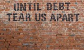 Debt. Until Dept Tear us Apart Stock Photos