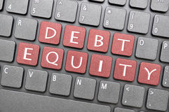 Debt equity on keyboard Stock Photo