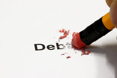 Debt Erased. Debt being erased by the end of a pencil, word implies debt royalty free stock photography