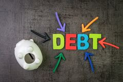 Debt, financial obligation that you borrow money and have to pay back concept, piggy bank with multi color arrows pointing to the. Word Debt at the center of stock image