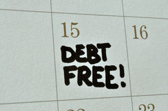 Debt Free On Calendar. Close up of the words 'Debt Free!' written on a calendar in capital letters, in black marker pen