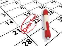 Debt free. Calendar with date circled with red text debt free next to red and white pen Stock Photography