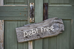 Debt Free. I am debt free sign on green doors Royalty Free Stock Photography