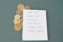 Debt list and Thai money on table Royalty Free Stock Photos