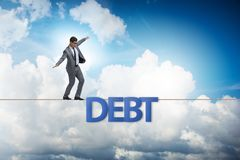 The debt and loan concept with businessman walking on tight rope. Debt and loan concept with businessman walking on tight rope stock photography