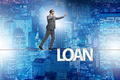 The debt and loan concept with businessman walking on tight rope. Debt and loan concept with businessman walking on tight rope royalty free stock photos