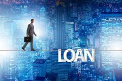 The debt and loan concept with businessman walking on tight rope. Debt and loan concept with businessman walking on tight rope stock image