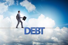 The debt and loan concept with businessman walking on tight rope. Debt and loan concept with businessman walking on tight rope stock photos