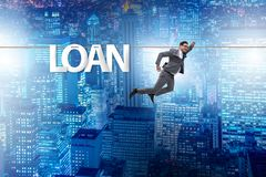 The debt and loan concept with businessman walking on tight rope. Debt and loan concept with businessman walking on tight rope royalty free stock image