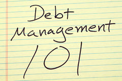 Debt Management 101 On A Yellow Legal Pad Stock Images