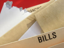 Debt problems. Mounting bills illustrating struggle with mounting debts Royalty Free Stock Photo