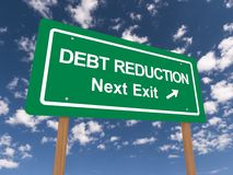 Debt reduction sign. Green sign with the words 'Debt Reduction'. Blue sky and cloud background Stock Images