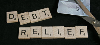 Debt Relief. A credit card is being cut in half Stock Photo
