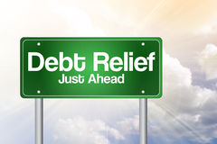 Debt Relief, Just Ahead Green Road Sign Royalty Free Stock Photography