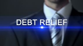 Debt relief, male wearing business suit touching screen, financial assistance. Stock footage stock footage