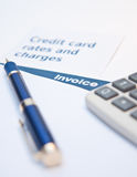 Debt situation. With credit rates, invoice and calculator Royalty Free Stock Photo