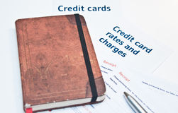 Debt situation with credit card rates. Debt situation with credit card charges Stock Photo