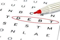 Debt in solving crossword puzzle Stock Photo