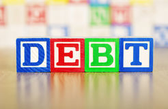 Debt Spelled Out in Alphabet Building Blocks Royalty Free Stock Photography