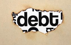Debt text on paper hole Royalty Free Stock Photography