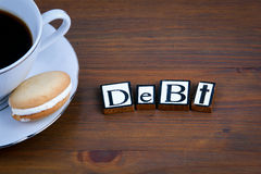 Debt text on a wooden background Royalty Free Stock Images