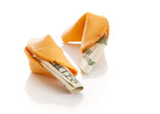 In Debt to China. US twenty dollar bills inside Chinese fortune cookies. Metaphor for American debt to China. Isolated royalty free stock images