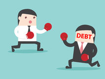 DEBT vs Businessman stock photography
