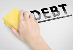 Debt word. Cleaning debt word on background Stock Photography