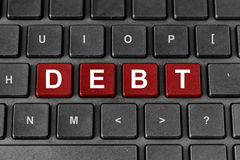 Debt word on keyboard. Debt red word on keyboard Royalty Free Stock Photography