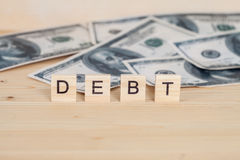 Debt word written on wood. Cube Royalty Free Stock Photo