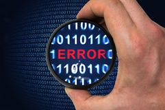 Debugging binary code with error written inside magnifying glass Stock Photography